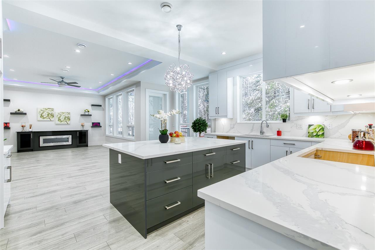 """ABBEY RIDGE, A BRAND NEW SUBDIVISION IN PRESTIGIOUS FRASER HEIGHTS. HUGH 5,669SF EAST FACING LOT (51? x 110?) Custom built by reputable builder - Shebaz Homes. Over 4,000 SF offers 6 BR 7 bath (5 full 2 half), 4 BR up and a legal 2 bedrooms suite & a potential bachelor suite. Main floor features  Great room concept plan, 10? ceiling,96"""" front door, Gourmet kitchen w/Hugh 6?x7? quartz island ideal for entertainment, a spice kitchen, den ideal for home office, engineering H/W flooring thru out. Upstairs has 4 spacious bedrooms (all ensuite), basement has media room an a powder room for upstairs use.  A MODERN & LUXURY BUILT HOME WITH ALL THE QUALITY FEATURES YOU CAN NOT FIND FROM AVERAGE HOMES. Easy highway access and only 5 minutes drive to private Pacific Academy"""