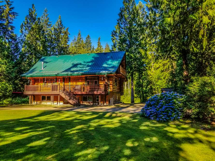 "LOVE AT FIRST SIGHT! This spectacular ""Artisan"" hand hewn Spruce LOG HOME will absolutely win your heart! Tucked away at the end of a quiet no thru street on the West side of mission, you will find this piece of paradise. Drive down the circular drive framed by majestic Douglas Firs, and enter into the Spotless Custom Built home with open concept and soaring vaulted ceilings. Enjoy the quiet of the country yet only 7 minutes to town. The main floor is an entertainers dream with huge island kitchen, living/dining room combo with gas potbelly fireplace. Large Master Bedroom on main floor, with adjoing full 4 piece bath complete with Clawfoot Tub. Full loft currently used as Master Bedroom complete with martini deck ovelooking manicured grounds. 3 More large bedrooms in basement. 2.9 Acre LOT"