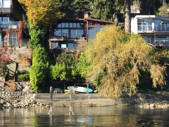Rarely available ?PRIME? Deep Cove waterfront. 8250 sq./ft lot (50 x 169). Gently sloping private ?sun-drenched? south facing lot. Original 2000 sq/ft contemporary post & beam house sits proud on lot capturing the 180 degree stunning panoramic water views. Value is in the lot. Great Opportunity to hold, renovate or build your waterfront dream home. Trophy waterfront properties like this are seldom for sale.