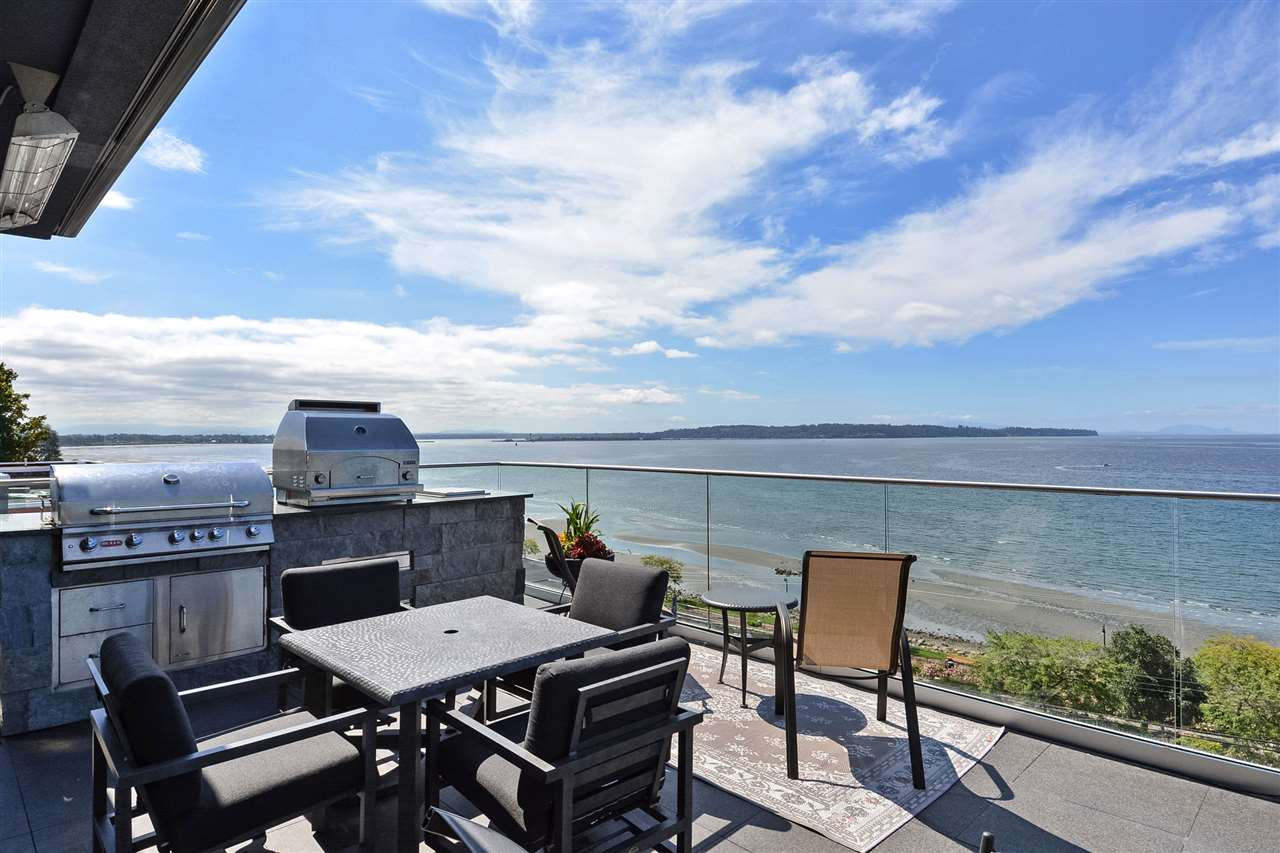 White Rock?s Finest. Stunning ocean & Mt Baker views highlight this impeccable custom concrete home. Perfect to live life to its fullest. You?ll feel like you?re holidaying in luxury resort year-round where you can entertain and wow from sun-drenched decks, create culinary delights in gourmet kitchen featuring Miele?s finest appliances while guests gather around the massive Quartz island. Ride the elevator down to climate-controlled wine cellar/tasting room. Catch a game at the spacious bar. It?s not all about the sharing though? the master suite exudes romance and decadence with a private ocean-front hot tub. The ocean breezes greet you as you wake energizing you for a brisk workout in your private gym. This home truly must be experienced to be believed! Detailed feature list available.