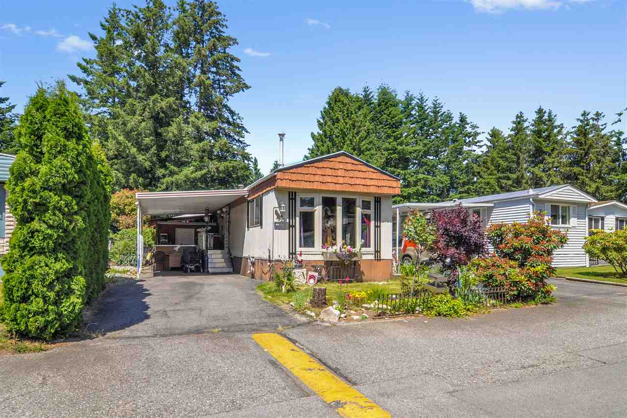 """CEDAR LANE - Affordable living in Brookswood! Well run 55+ park in Langley. Beautiful private setting with fenced yard and 2 storage sheds.  This two bedroom, 1 bathroom home has a spacious layout. The kitchen features stainless steel appliances and stainless steel countertops. Pad rental includes water, sewer/septic, garbage/recycling, clubhouse and management. Pets welcome - 1 dog (up to 14"""") or 1 indoor cat allowed. The park offers additional RV parking if needed. Do not miss this opportunity to live in one of the most desirable parks in Langley!"""