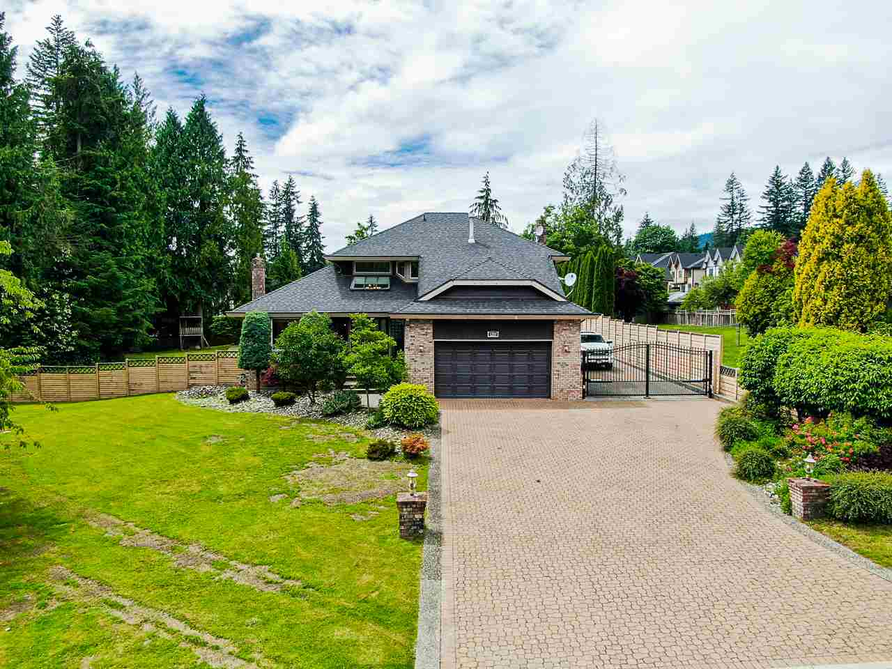 Welcome to this luxurious Family Estate located in Coquitlam?s coveted Burke Mountain neighbourhood! Private, Gated, 1 Acre Lot with plenty of future development potential. This exceptional floor plan features 4 bedrooms, 4 bathrooms and a fully finished basement that includes a spacious Games Room, Rec. Room and Theater. Enjoy entertaining in your very own resort-like, sun soaked backyard which boasts an amazing pool with waterfall, games + wet-bar area, covered hot tub, bbq and built-in fireplace! 2 car garage and large driveway create ample parking with plenty of room for an RV, while security cameras surrounding the perimeter give you peace of mind. Meticulously cared for, air conditioning throughout and centrally located near schools, shopping & more. This home truly has it all!