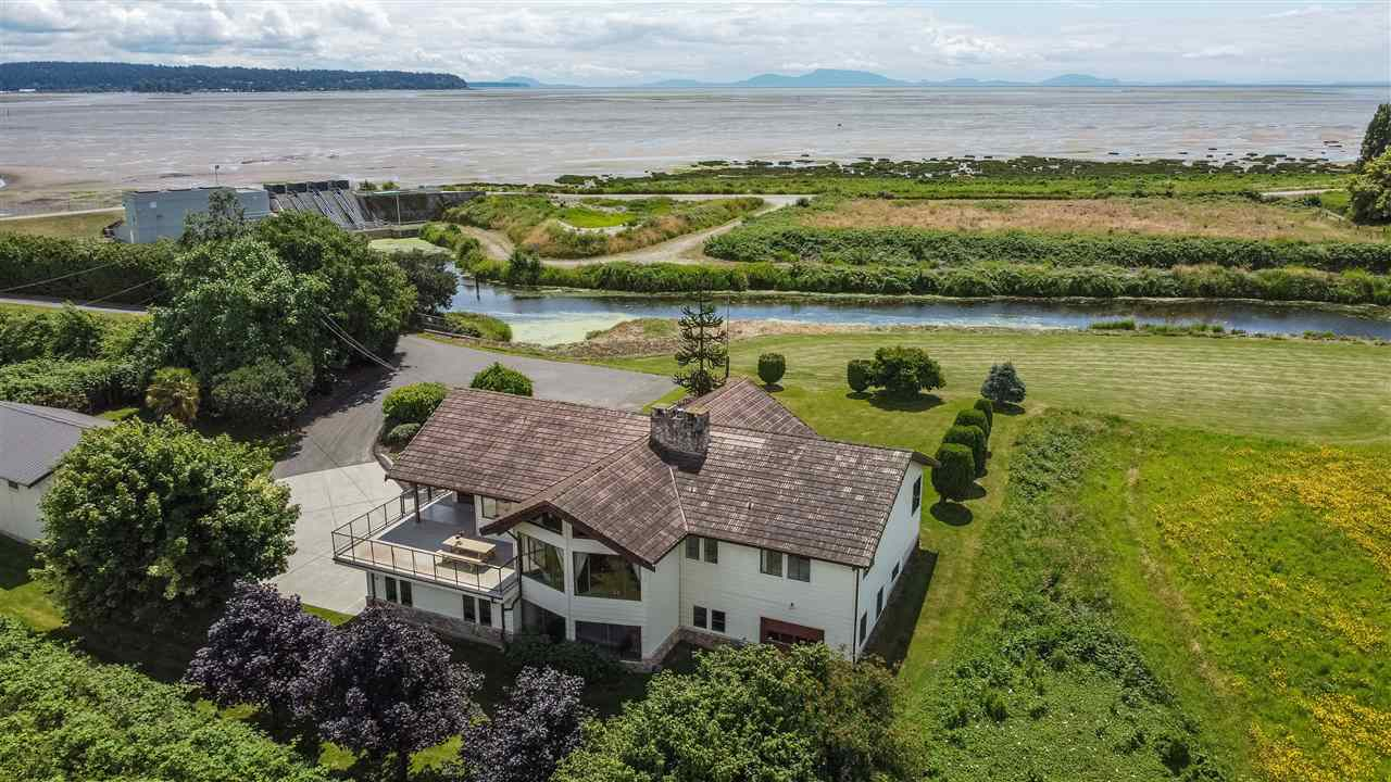 Once in a lifetime opportunity! This incredible 2.54 acre waterfront estate property just steps to the ocean and overlooking beautiful Boundary Bay is a dream come true. One-of-a-kind home - panoramic views from every room, vaulted ceilings, 3 car garage, plus detached shop with RV/Boat storage too. There is room for everything. The spacious master retreat is fabulous, with breathtaking panoramic ocean views and a recently updated bathroom. This gated and secure property is secluded yet only minutes to Hwy 99. Over 1200 sq ft of unfinished space below offers many different options for a large family, including the option to add a suite if desired. This is an amazing property, don't miss your once in a lifetime chance to own a fantastic home on 2.54 acres of prime waterfront in Ladner