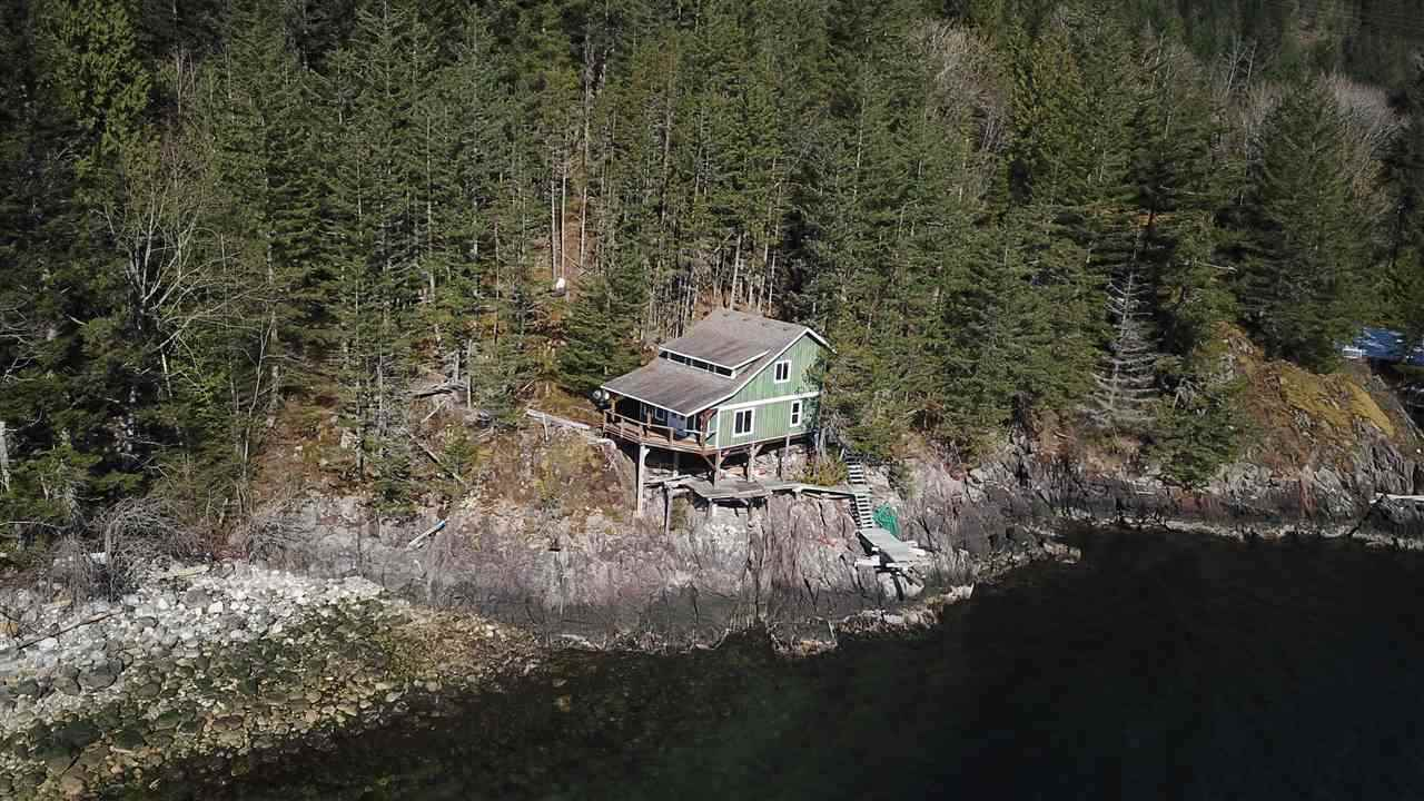 """Stunning 1.18 Acre Oceanfront Property located in """"Five Coves""""on the Howe Sound. The private property is forested, and located right on the ocean, and next to the rocky shores. The 20 lot community also hosts a community dock and pebble beach. This cabin was constructed in 2007, and awaits a new owners finishing touches on the interior. The interior can be configured with kitchen/bath/bedroom on main floor with two bedrooms up (currently interior is unfinished). Access to this lot is boat access only - 15 minutes by boat from Porteau Cove and 45 mins by boat from Horseshoe Bay."""