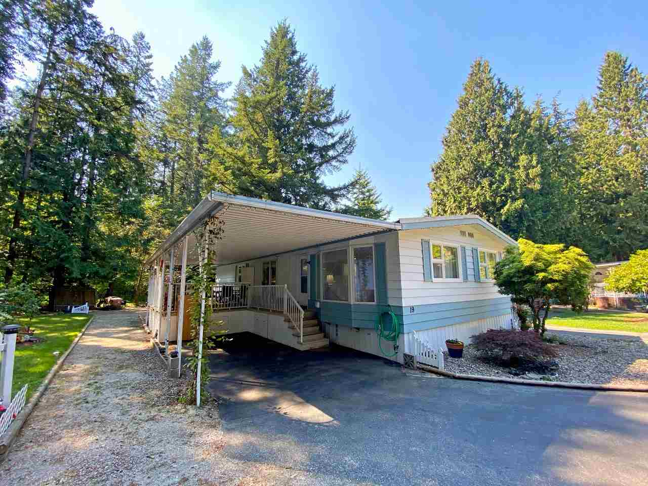 """CEDAR LANE SENIORS PARK -  Over $30,000 in recent updates! 55+ mobile home park in Brookswood. Rarely available renovated double-wide manufactured home. This unit includes a massive kitchen / living room / family room area; HUGE covered 14 x 14 deck; a large master bedroom with en suite; a detached powered workshop (220v / 40 amp service); and the largest private pad in the park. Recent updates include: laminate flooring (2017), kitchen appliances (2017), lighting, paint, countertops and backsplash (2019). Roof has thick asphalt membrane material. Walking distance to bus stops, grocery shopping, pub, and coffee shop. One small pet OK (dog up to 14""""). Very quiet area. Do not miss out!"""