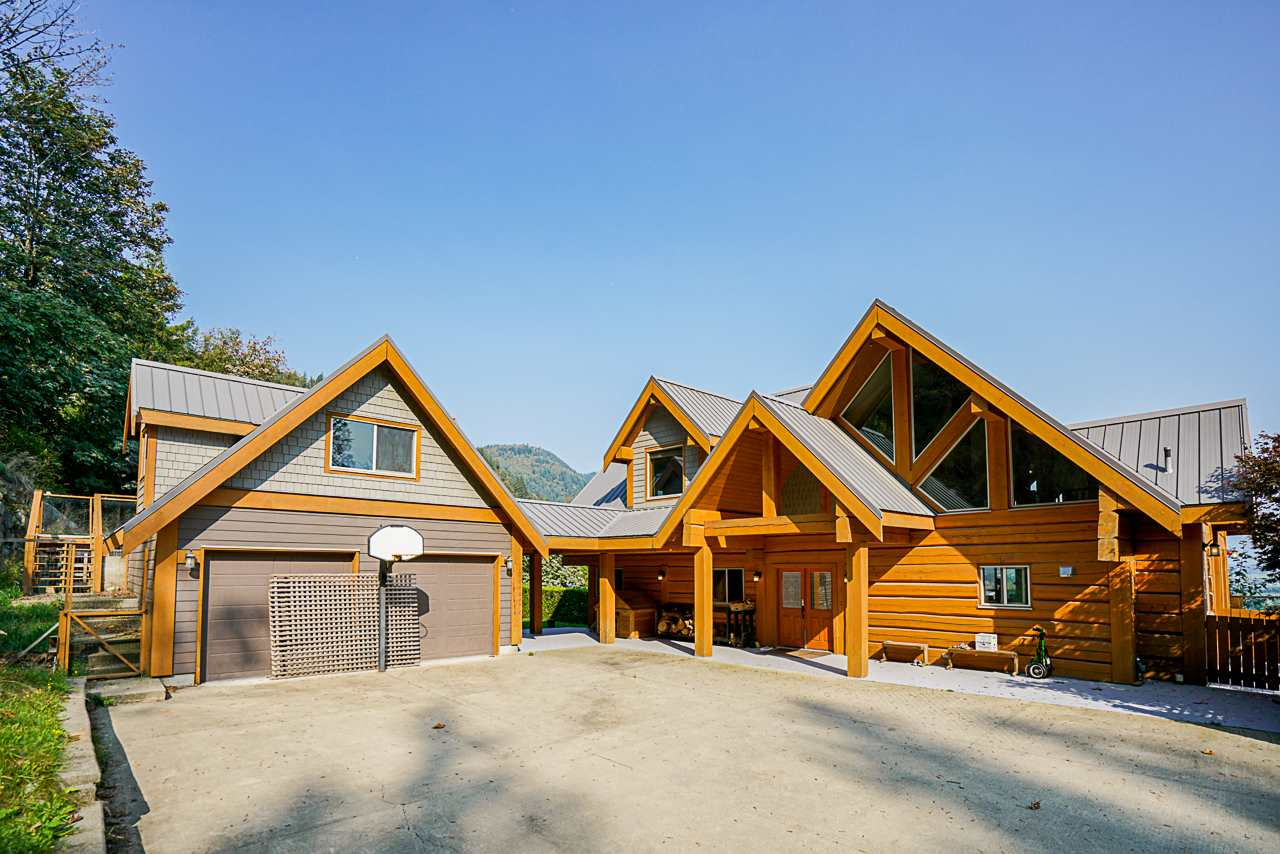 INCREDIBLE HOME FOR SALE ALERT. Own your piece of Amazingly built,bright Square cut Log Home perched on nearly 12 ACRES of private land, overlooking breathtaking views of Mt. Cheam, Fraser River, and Sumas River. If a private estate home is what you are looking for,LOOK NO FURTHER. This is an Open-concept house with a master on the main, a fully equipped Luxury ensuite with soaker tub and large deck 25'x25' to take in the vista, Vaulted ceilings with beautifully exposed wooden beams. 2 large kids bedrooms up and a loft area. The Lowest level is fully furnished and has a large family room, movie theatre, 4th bedroom, laundry, storage and full bathroom. On top of this, this home has a large outdoor entertaining area including pool, hot tub, wet bar & fire pit. Includes 2 stalls and paddocks.