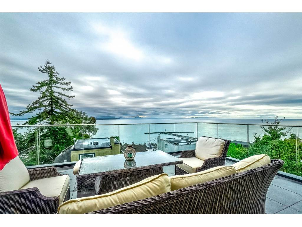 Panoramic Ocean, Island & Mountain views from every level, builders own custom built architecturally designed home, over 5000 sq.ft. on 4 floors, 9 ft ceilings, multi slide patio doors on the top 2 floors, floor to ceilings windows, composite flooring, radiant infloor heating, air conditioning/HRV system, gourmet kitchen, high end Miele appliances, spice kitchen with pantry, elevator, Master bedroom & 5 piece ensuite, hot tub and his and her walk in closet, soundproofing between floors, soundproofed Media room, voice activated smart home system, over 700 sq.ft. of outdoor living space, corner lot off Royal Ave, full 2 bedroom suite, 2 large heated double garages with total parking for 10, roughed in electric charger, central location steps to shopping, transportation, Semiahmoo catchment.