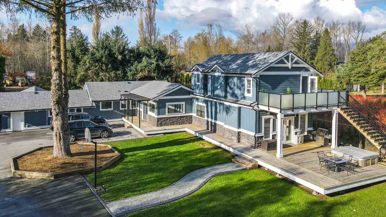 5 acre flat useable gated estate in central Maple Ridge. MAIN HOME  completely renovated in 2018 with every luxury option including professionally maintained hot tub. 4 bdrm 3 Bath. Gourmet kitchen. Heat pump 50 year roof. SHOP BUILDING. Fully renovated 2018. 200 amp 3000 sqf total 1500 sqf shop 1500 sqf suite with bar games and wine cellar 50 yr roof CARRIAGE HOUSE. 600 sq ft brand new 2016. SPORT COURT. 85?x 35? fenced court  3.5 ACRE YARD. Landscaped with pond fire pit outdoor bbq area $50k in Allen block FLAT SEPARATE GATED ACRE. Lay down yard for company equip. ULTIMATE RV PKG. up to 42? motorhome w/ 30amp hook up and full sewer hook up to septic. BONUS  2017 engineered septic. Plus 2 year Mtnce pkg on all mechanical and pump stations. Total 5380 sq ft.Don?t miss this gorgeous estate.