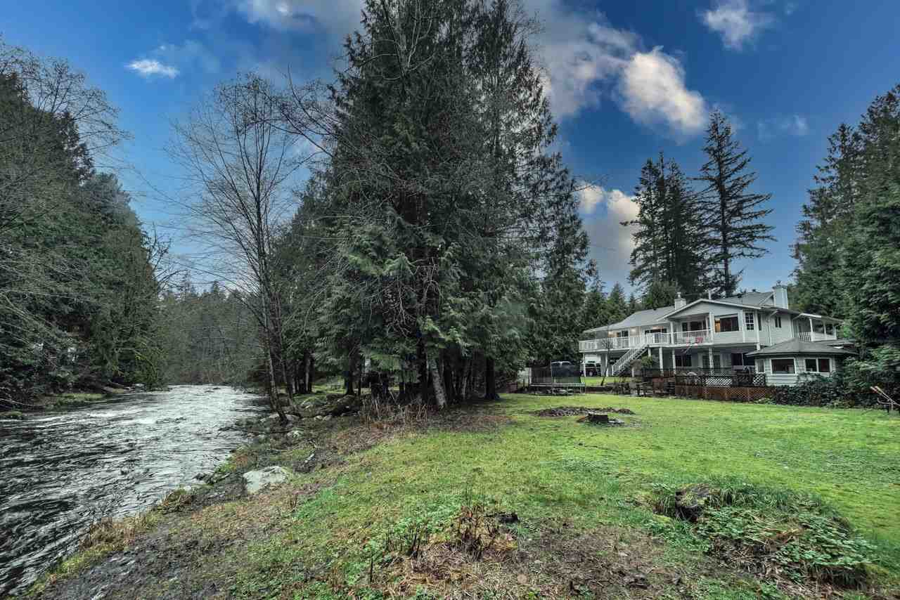 Majestic Riverfront Estate 1 RIVER LIVING on the South Alouette River stretch of low bank waterfront paradise. 2 RECREATION steelhead fishing swimming & tubing, riverside campfires and picnics. 3 LAND & WATER 2/3 of an acre with lush greenery The property line extends mid river and in front of 2 adjacent neighbors.  4 RANCHER with basement. three bedroom rancher with a daylight walkout bsmt easy to suite Amazing up close river views from eat in kitchen, living room, master bedroom. Quebec birch wood floors through most of main floor. three fireplaces, sunken living rm with vaulted ceiling, oversized windows & wrap around covered deck. 4 PARKING/TOYS Huge RV blacktop parking, large double car garage/shop. Room to add more. 5 SOLID HOME  1990 construction, on city water & sewer. See video