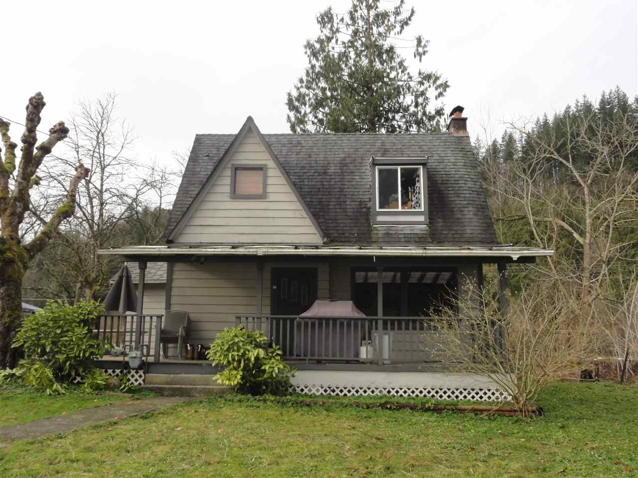 Investors take note 4.66 acres with a charming 1930's home with 1 bedroom on main, wood fireplace, loft offers a bedroom and sitting area, large deck off dining area and wraps around front entrance, 38x23 garage/shop both in need of TLC. Bonus 520 sq.ft. quaint 1 bedroom 1 bath self contained cabin (not in measurements) in good shape with fenced area. Lots of room to drive through for truckers. Few other out building for dogs/chickens?, water rights from Ball Brook, bring your ideas great property for the handyman or investor to rent out. Call for your realtor today appointments are a must dog on property.