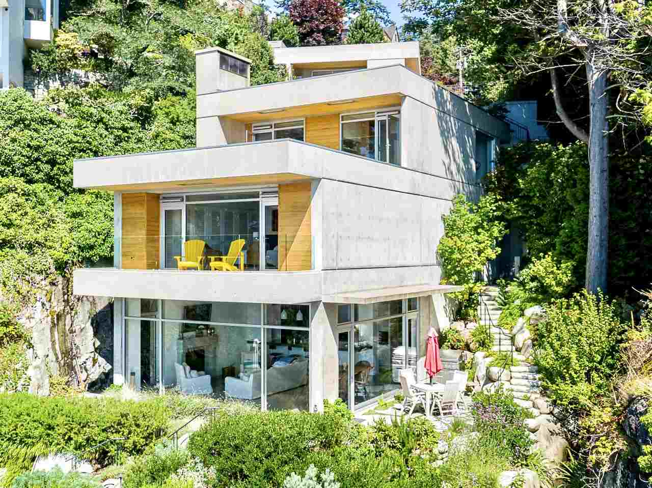 Gleneagles waterfront masterpiece, completely private beach house. Approx. 4,387 sq.ft (incl. garage 423 sf & storage 168 sf) on 3 levels (Main 1,313 sf, Above 1,592 sf, Top Floor 654 sf + Studio 237 sf) - see floorplan. Luxury finishings, concrete, steel, wood & custom floor-to-ceiling sliding windows, European white oak and polished concrete floors. Casual, yet elegant with jaw-dropping views from main rooms. Indigenous landscaping, babbling creek, waterside terraces, & access to your own private beach. Additionally, this home features a firepit, home automation, A/C, radiant ht, water filtratn, garden irrigation, elevator, top-grade appliances, gas generator, fibre optics ready, 3 green roofs. This exclusive property is world class and provides the ultimate in luxury oceanfront living!