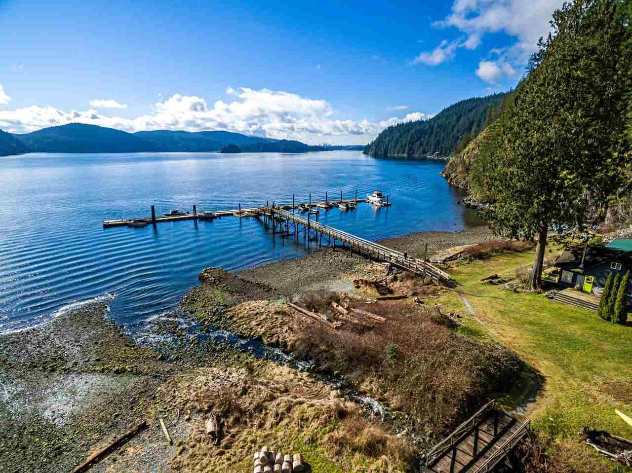 Why buy a one bedroom condo when you can own a gorgeous log home on a 30 acre parcel of peaceful waterfront land- only 10 min to North Vancouver by boat! Be new proud land owners in the wonderful seaside community of Brighton Beach, Indian Arm. Large 3 level-3 bed family home is perfect for those wanting a more remote and independent lifestyle with quick boat access to Deep Cove and easily commutable to the city. Plenty of space here with large main living room, 3 beds, 2 full baths and a massive games room downstairs with wet bar! A wonderful new chapter awaits for those seeking new adventures in the heart of nature. Wake up to life surrounded by lush forests, waterfalls, and fresh crab and prawns right outside your front door. Outdoor pursuits are endless here with hiking trails galore behind this fabulous ocean view property. Escape the daily grind and live out your dreams in this idyllic waterfront community.