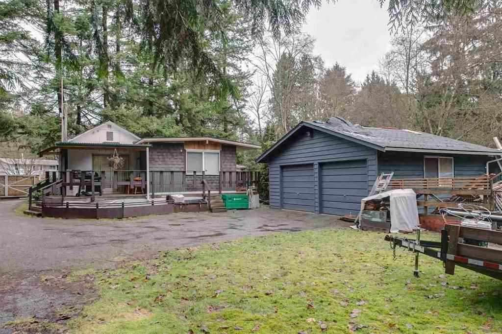 Private 19,471 sq.ft. acre paradise in the heart of Port Kells with 150' frontage in an area of estate homes. Build your dream home on this treed lot or continue to rent to tenants. Den is a 3rd bedroom. Home has hardwood floors, double windows & a 10'x12' rear deck. The 24'x22' detached double garage has 220 amp power & the lot has plenty of room for extra parking. Great value! Easy commute to anywhere. Just minutes to Highway 1, 15 or 17, Fraser Highway or Golden Ears & Port Mann Bridges. Rented to Good Tenants at $1800 plus utilities on a month-to-month basis. Possibility to build 3 Level Home.