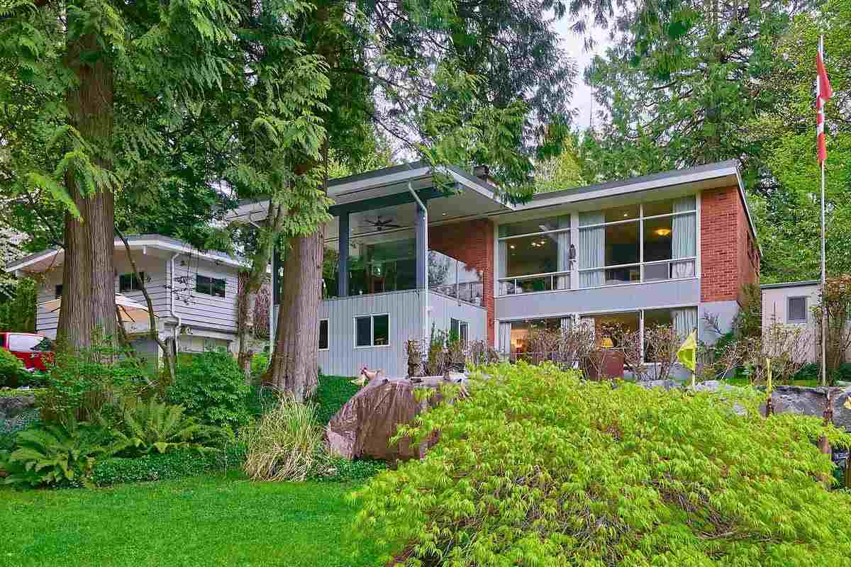 4 acres. Amazing private acreage that is designated 1 acre minimum in the Official Community Plan. Features 3 bedroom 2 bathroom home with separate 2 bedroom suite with access to 244 sqft solarium. The main floor has large living room with the second fireplace vinyl plank floors and sliding door to covered 255 sqft  deck with glass railing with westerly view over the two private ponds with water fall and 2 bridges, This outstanding landscaping has bolder walls, mature evergreens, greenhouse, garden shed and 4 car detached garaged wired and plumbed with air compressor.Recently updated bathroom and flooring and new glass-enclosed deck with privacy and views of the woods and ponds below. Very special and shows fabulous