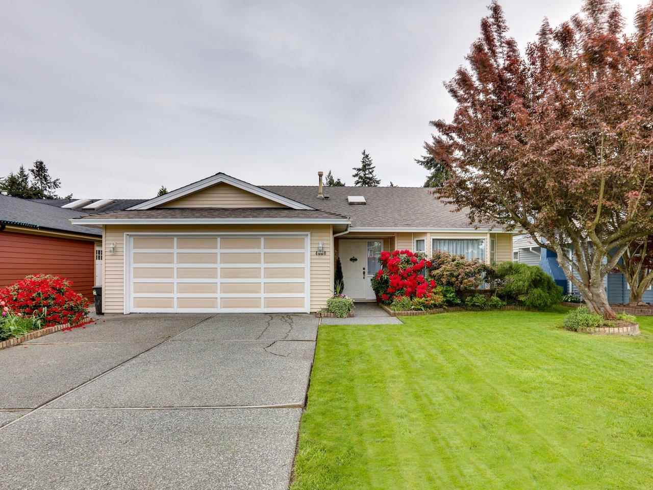 Charming 3 bedroom rancher in one of Ladner's most desirable areas. This home features a very functional design with 1500 sq ft of living space and includes a traditional living/dining area that is large enough for family gatherings. Spacious kitchen with stainless steel appliances opens up to the cozy family room with gas fireplace. Covered patio off family room is great for all season BBQ's. Large master bedroom with walk-in closet and 3 piece ensuite plus 2 more excellent sized bedrooms. Meticulously kept and ready to move in. Additional features: newer furnace and hot water tank, Penfold roof, crown mouldings throughout, large bright foyer & 2 car garage. Walking distance to shops, transit, recreation and quaint village of Ladner.