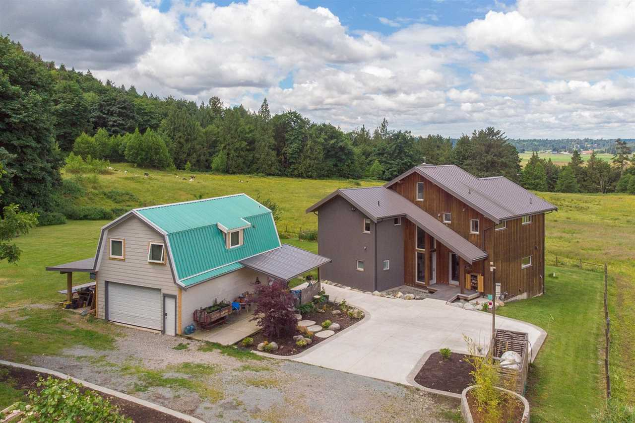 Peaceful, private, breathtaking view are just a few words that best describe this 2 acre property  tucked away in the quiet North Bradner area of Abbotsford. Surrounded by neighbouring treed hillside and rolling pasture land, this custom three-story, four bedroom three bathroom home has been designed to maximize the majestic views of the Fraser River and Valley as well as the surrounding fields at your doorstep. Beautifully appointed country kitchen with quartz countertops, stainless steel appliances and gas stove. Bonus detached two bedroom coach House for the in-laws or extended family finishes off what is a perfect example of what small acreage living can offer.