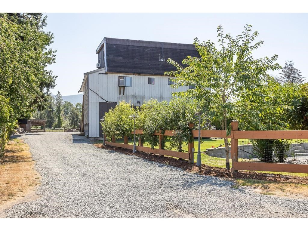 Located in Yarrow on a quiet dead-end street, this beautiful acreage has endless opportunities. Minutes from Hwy 1, Cultus Lake, Yarrow Elem., Comm. Hall and Library. Appreciate the small-town atmosphere while surrounded by mountains. If you enjoy fishing, you are only a few minutes walk away from the well known Vedder River, in addition to hike, bike or bring a horse. Close to school, recreation, restaurants, and shops. Workshop with perfect man cave. Ground level 1-2 bdrm mortgage helper or in-law suite. Easily pick fruit from a variety of apples, pears, cherries, and assorted plums, apricot, figs, and raspberries.   Ample parking, for your RV?s and toys behind the house. A great outdoor space to entertain guests while you enjoy the sounds of nature and star gaze.