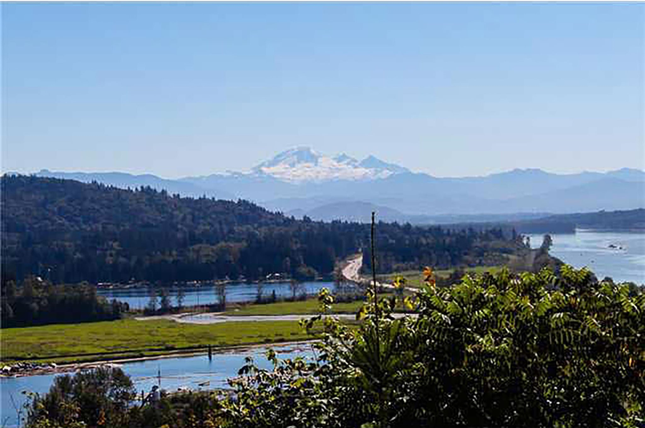 PICTURESQUE - MOUNTAIN RANGES, FLOWING RIVERS AND SHIMMERING LAKE VIEWS. Top 5 reasons you will want this beautiful estate 1) VIEWS: Mt Baker, Silvermere Lake & Fraser river to mention a few. Full 180 deg. of views from every window 2) PRIVACY: Just under 4 acres of manicured perfection, gated, long circular driveway allows for ample parking & structures to be added in the future 3) LUXURY: 4178sq ft Rancher w/ daylight basement equipped with amazing country kitchen, roaring fireplaces, sprawling decks, full bar, spa bathroom & custom wine room 4) LOCATION: Unique plateau lot, close to a wealth of outdoor amenities 5) RARE: this isn't your average property - a rare mix of unbelievable pride of homeownership.