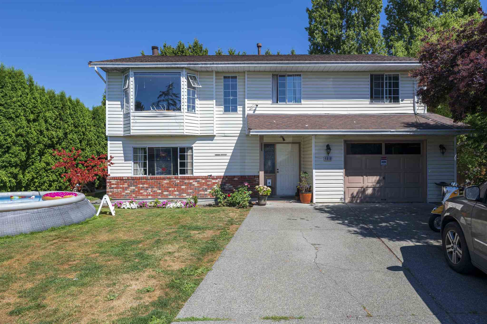 Fabulous 5 bedroom home with a legal suite in family friendly neighbourhood near Bell Park in Ladner. Basement entry with private, fully fenced backyard. 3 bedrooms upstairs including master bedroom with full ensuite. Downstair boasts a legal 2 bedroom suite with separate entry.