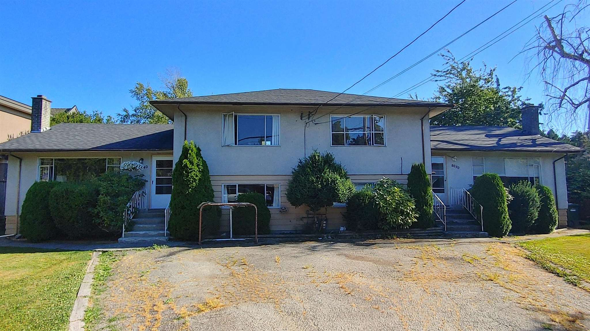 Fantastic duplex that sits on a large, private subdividable 93x132 SF lot (total 12,263 SF lot) with great north / south exposures.  The side x side duplexes each have approx 1400 SF, 2 bdrms and 1 full bath upstairs, 3rd bedroom / large rec room downstairs, separate laundry facilities and a huge south facing backyard.   Great property to enjoy one or both sides, to hold as an investment property or to build 2 new dream homes of 3089 SF which does not include the garage.  All this in a nice family-oriented neighbourhood that?s centrally located close to buses, shopping, Garden City Elementary, Palmer Secondary & Garden City Shopping Mall.
