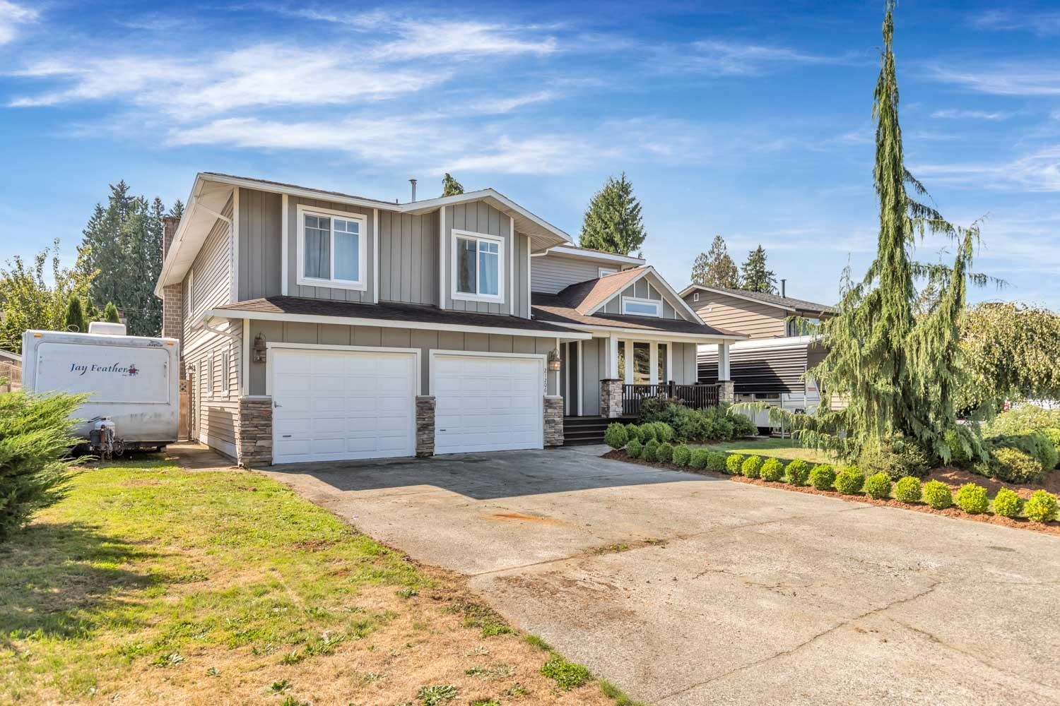 3,200sqft IN NORTH WEST MAPLE RIDGE!! This home had an extensive addition / renovation completed in 2013 w/ all the appropriate permits and engineered drawings. This home features 5 Bedrooms & 5 Bathrooms! Each bedroom HAS IT?S OWN ENSUITE! Features include an Updated Kitchen w/ Granite Counter Tops, Stainless-Steel Appliances including your Double Door Frigidaire Fridge! Other updates include: Modern Paint Scheme, Engineered Hardwood Flooring, Vinyl Siding, Central Vac., Composite Front Deck, New Hot Water Tank, Newer Windows, Newer Roof, extra Storage & a Flat Fully Fenced Private Backyard! All of this located in a quiet Cul-De-Sac just moments away from Volker Park, Laity View Elementary School, Chilcotin Park, West View High School, Abernethy Connector & Transit & much more!!