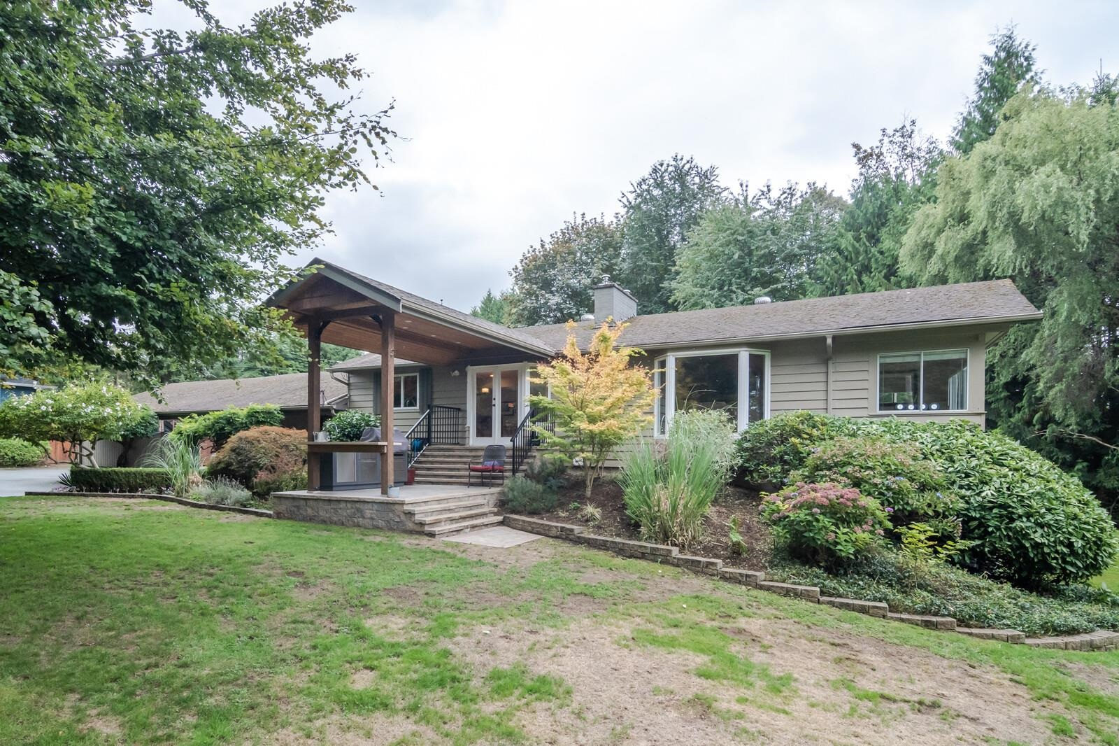 EXCEPTIONAL PARK LIKE 1.5 ACRE parcel located in premier WEST MAPLE RIDGE. LOVELY 4 bed + 3bath + 3 F.P's remodeled home highlighted with abundance of stylish features. Modern kitchen with Island, granite countertops + high-end appliances. Huge Master bedroom features 5pc ensuite + overlooks solar inground pool. A/C home, stunning yard +landscaping. 2 DETATCHED WORKHOPS (30' X 35' + 16' X 24') Greenhouse + detached RV carport located at end of lightly traveled street. Entertain in uncrowded comfort + absolute QUIET PRIVACY. BUILDERS + INVERTORS TAKE NOTE: REZONING taking place for 4 LARGE RS!B CUL-DE-SAC LOTS. PICTURESQUE PRIVACY.