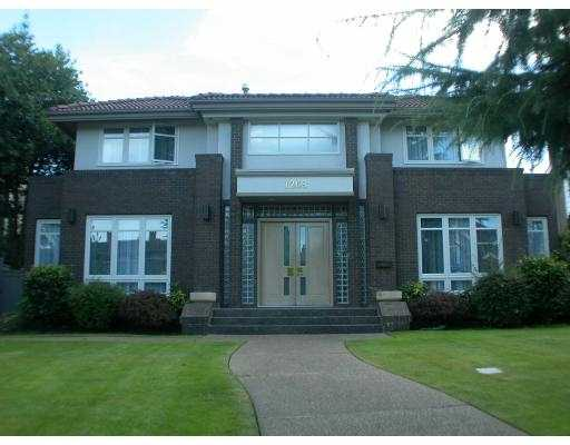 14 yr old 5041 sq.ft.custom designed home on a 68 x 123.8 lot. North facing in s ought after Shaughnessy area. Elegant home with excellent floor plan offers 4 be drooms up, 2 bedrooms down, plus media rm, hot tub, wet bar, etc. Very convenien