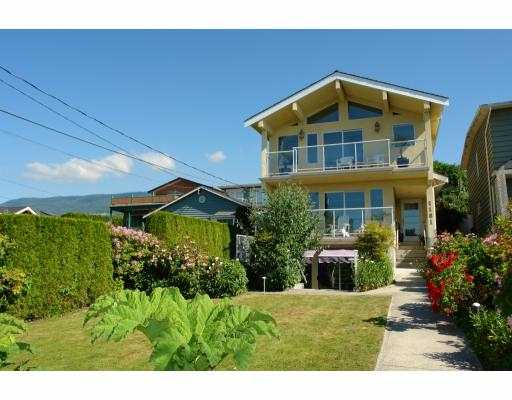 """Sit on a fabulous ocean view ppty in the heart of Lower Ambleside is this magnificent custom-built home offering approx 3123 sf on 3 levels. Exceptional quality & detail throughout w/ large picture windows, vaulted ceilings & an ample useof skylights. Feats incl a sensational """"Poggenpohl"""" gourmet kitchen w/ breakfast bar, E/A & adjoining fam rm - all opening on to a private patio & sunfilled backyard. Additionally, this home offers a large LR & DR, 3 spacious bdrms up incl a gorgeous master & spa-like ensuite w/private balcony, 3 roaring F/Ps, an elegant foyer entry, separate 2-car garage w/lane access. Down incl a large rec/media rm, guest bdrm & utility rm. Lovely mountain view from back of home. Simply stunning!"""