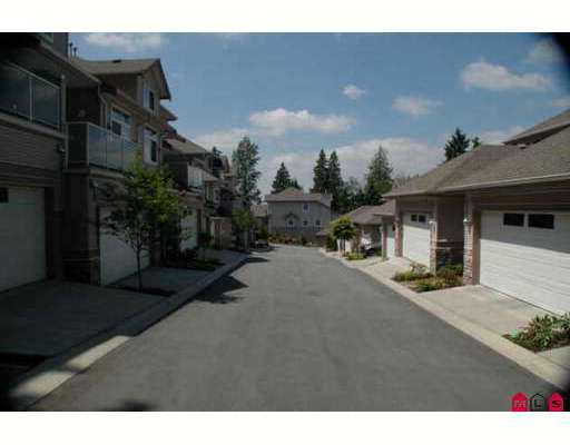 Nature's Sweet Serenity! Look No More! THIS SWEET HOME IS for you! Spacious 3 Bd rm + Den T/H End Unit, w/ suite potential; beside nature w/ Mtn view on ALL 3 le vels! Liv area approx. 2622 sf; move-in! A must see in your return to Nature'ssurroundings. Extensive landscaped garden joins the home to the wooded area. Quiet end of cul-de-sac. Level drive in w/ walk-out basement. A diamond among precious stones. Cls to Patullo and Alex Fraser and west of Scott Road (120th) between Elevator  Road and Grace Road entrances off South Fraser becoming River Rd. Tanny or Grace to South Fraser heading South or River Road heading North veer right just passed Elevator Road.