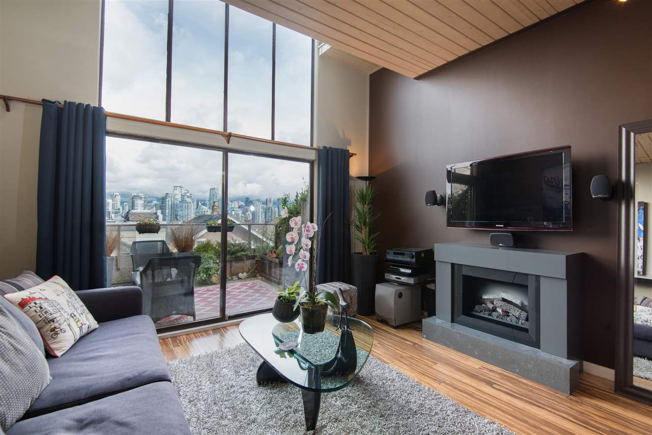 """Bring your fussiest buyers! They will fall in """"LOVE"""" with this gorgeous, bright, 2 bdrm (incl. loft bedroom) & den with over 1100 sf townhome. Stunning False creek, North Shore Mountains & Downtown views can be seen from your Northwest outlook. The layout in this lovely suite feels much larger than it is and feels like a """"house"""". Vaulted ceiling, s/s appliances, stone counters, custom concrete f/p and mosaic tiles are a few features here. Location! Walk to Granville Island, Granville or Broadway shopping, or enjoy your coffee from local """"Wicked Cafe"""" as you stroll down to the doggie park...yes pet/rental friendly. 1 parking/1 storage. This one was worth waiting for. OPEN SAT/SUN 2-4"""