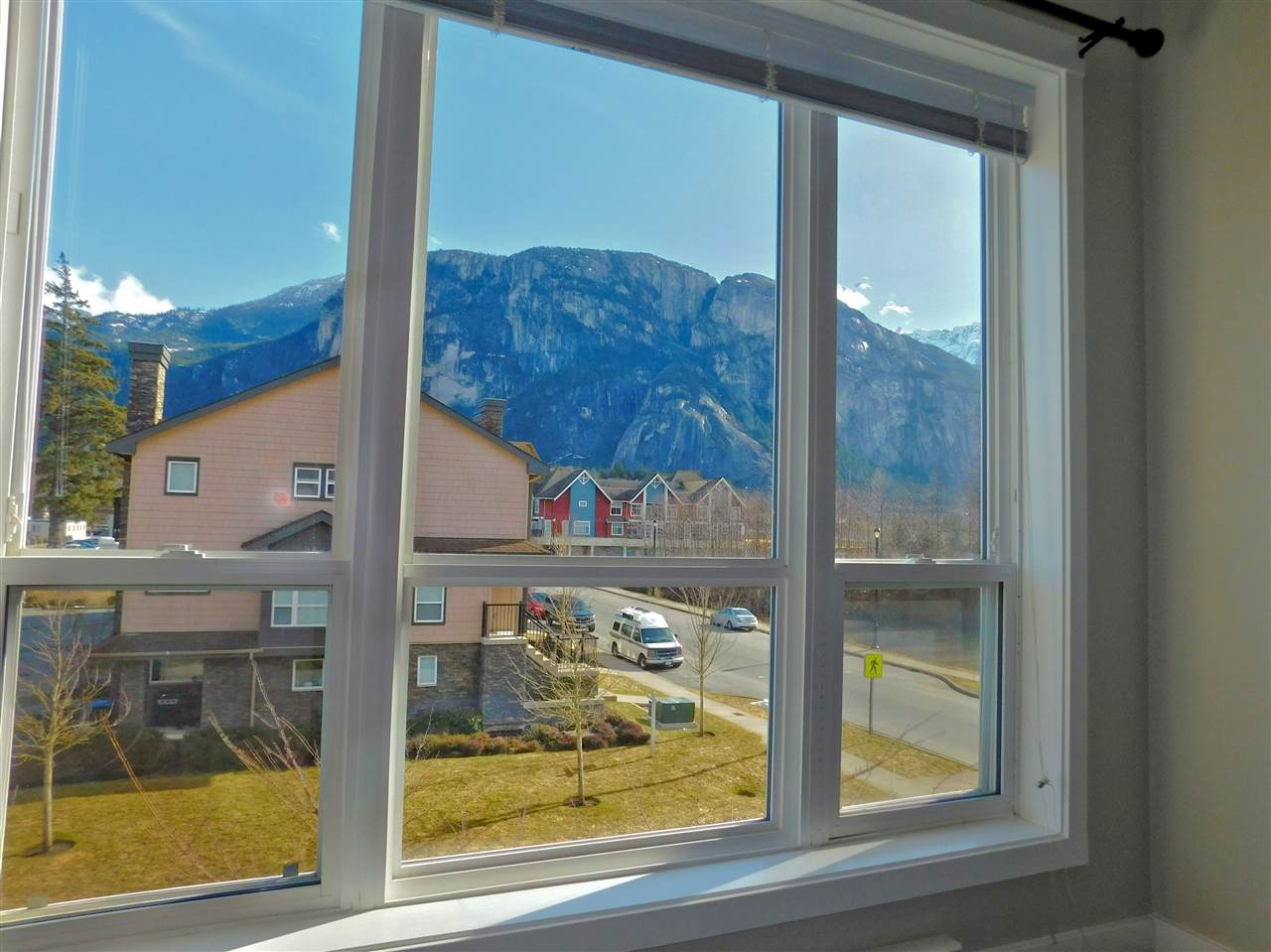 Come home to SKYE - your fabulous and spacious 4 level townhome with breath taking views and excellent walk score. The setting is amazing with open green space. Loads of room for play, office or multi use in oversized and bright loft. Enjoy your morning coffee in this south facing unit located just a minute walk from the library, Marina, biking trails, boating and all other amenities you would need. Bonus room in basement with windows and success from garage as well to conform to your needs. Single garage. Love to garden? Community gardens are located just a minute walk away at $30/year (depending on availability). Commute to Vancouver or Whistler in just 45 minutes. Immaculate, owner occupied unit. Call for a private tour.