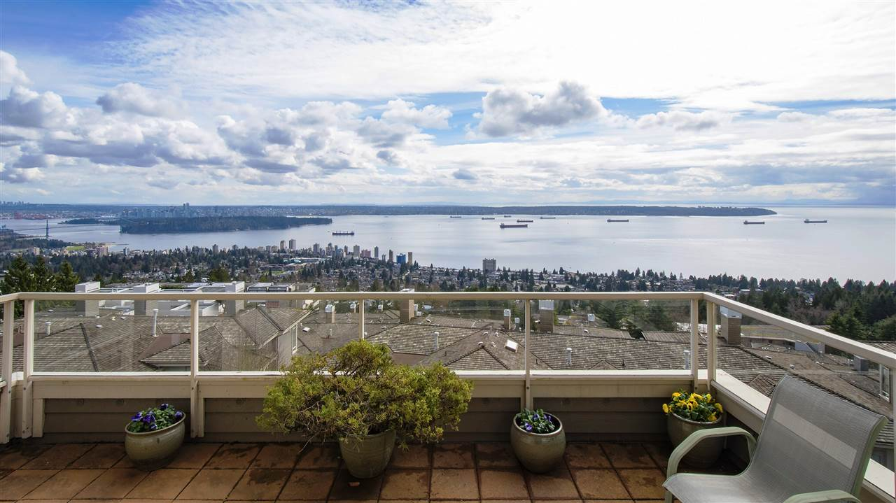Unobstructed 180 degree views from this large duplex style townhome at the highest point in Salishan!  Enter into a spacious main level with vaulted ceilings and large living areas all facing towards the absolutely stunning views of Downtown Vancouver, Stanley Park, Mount Baker and Ocean towards Vancouver Island.  A Polygon Built home with high quality finishes including maple hardwood floors, Sub Zero Fridge and granite counters in kitchen and radiant heating.  Dual master suites with walk in closets and spacious ensuite bathrooms plus large rec area on lowest level with access to over 500 square feet of dry crawl space storage.  This home also includes multiple patios and an attached 2 car garage plus room for visitor parking in front.  Approximately 2,900 square feet on 3 levels provide