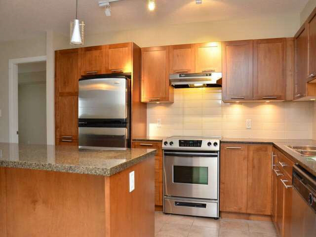 Welcome to FAIRWAYS, this is a place that offers resort like living. FANTASTIC 2 BEDROOM (on opposite sides) + DEN, 2 full bath, Spacious open concept that FACES GOLF COURSE/MOUNTAINS. This unique open plan living is located on the ELEVATED first floor, & provides a beautiful scenic view through every window. Imagine sitting on the covered patio sipping your morning coffee looking at the 18th hole and the magnificent mountain view of the Golden Ears! Kitchen with usable island/granite/S/S appliances/shaker style cabinets. Includes access to the garden, clubhouse, gym, sauna, games room, bike storage, guest suite & onsite Caretaker. This unit comes w/additional storage and 2 side by side parking spots. Bring your friendly pet, golf attire, and BBQ. Your search stops NOW. Call today.