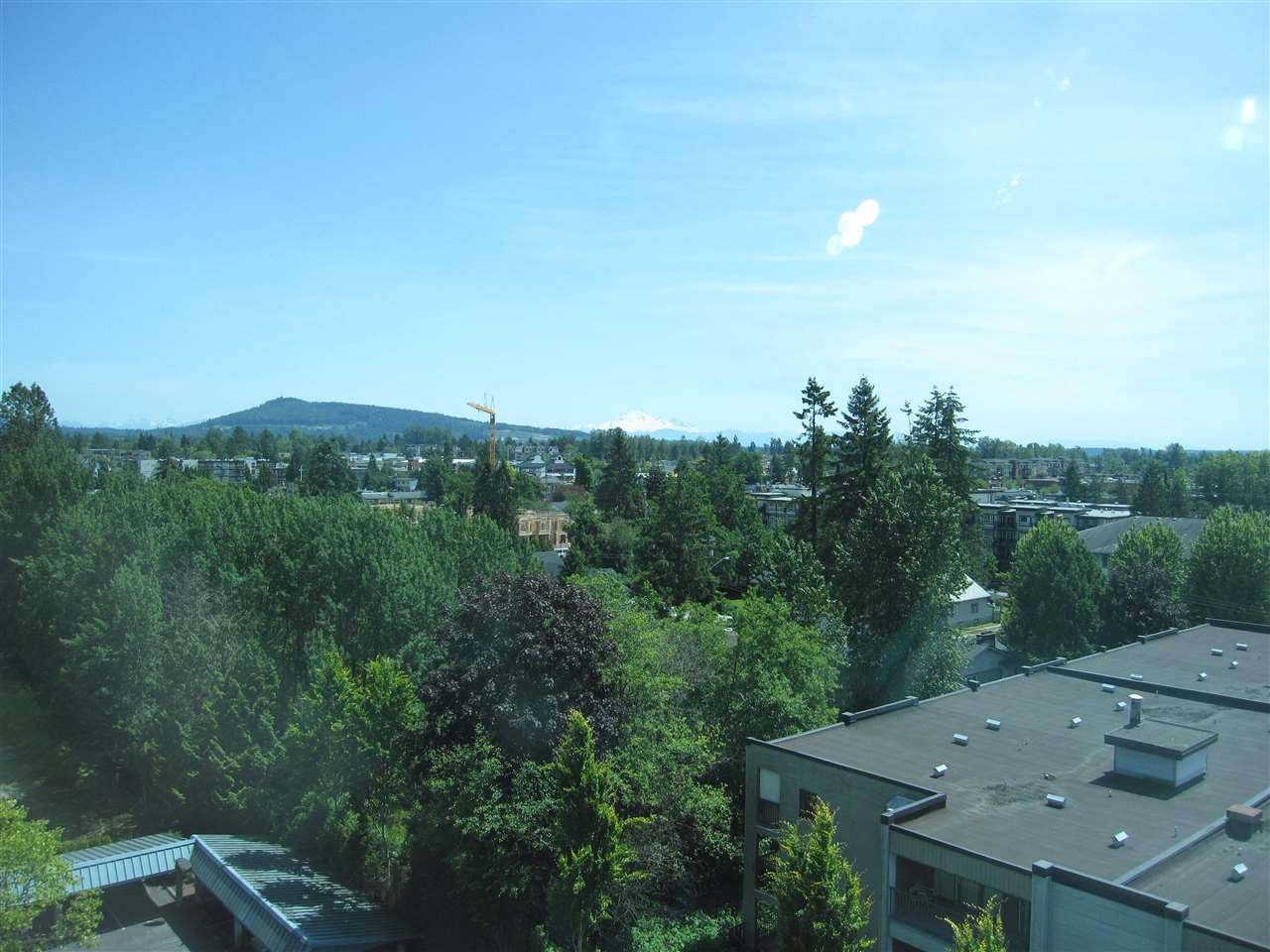 This 2 bedroom + Den suite in Panorama has amazing SOUTH FACING 180 DEGREE VIEW. Modern open concept living rm, kitchen, dining area with gas fireplace in living rm. This Maple Ridge's sought after adult oriented complex. The seniors centre offers fitness classes, hair salon, craft room, cafeteria, billiards room, prepared meals and various other daily activities. Such a great location with transit right outside the building and an easy walk to downtown Maple Ridge with its library, recreation, restaurants and shops.
