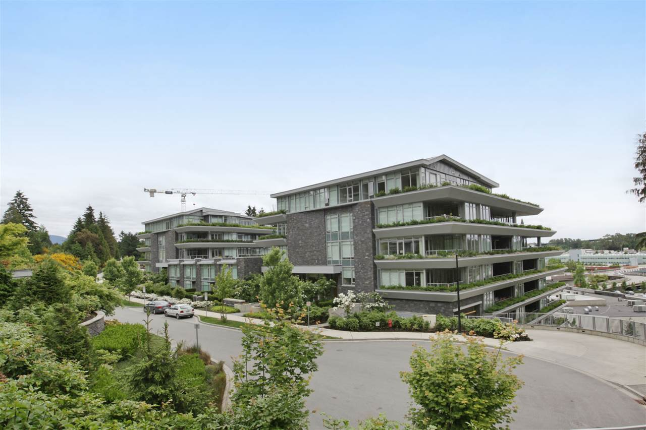 Welcome to the Evelyn community. This ideal location has Park Royal within walking distance & is close to transit access, Lions Gate Bridge, HWY 1 & 99. This well planned two bedroom + den home features a large 200 sf terrace. The master bedroom has a large ensuite and walk-in closet. Interior features include high-efficiency full-size washer & dryer, automated lighting & sound control with built-in speakers. Flooring is engineered oak hardwood, porcelain & travertine tile. Kitchen has high-end SubZero, Miele and Asko appliances. 1 parking & 1 locker included. This building has fitness center & concierge service.