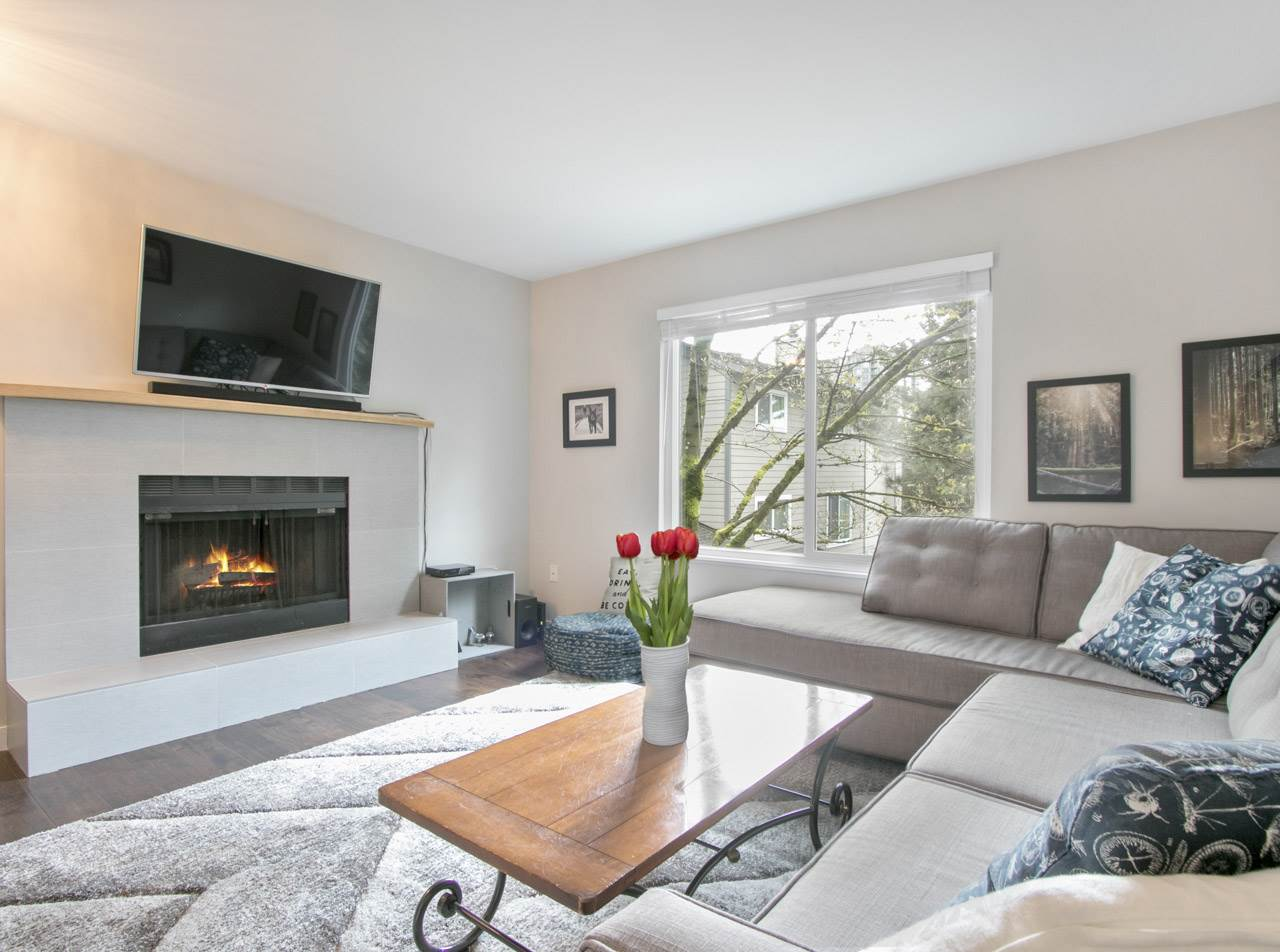 STUNNING TOWNHOME in the heart of Port Moody. This bright and open 1,226 sqft home was completely renovated in 2015 and features a gourmet kitchen with new SS appliances & contemporary cabinetry, updated bathrooms, cozy wood burning fireplace and rich flooring throughout. Walk out to your massive private patio with fenced yard and host a summer BBQ for all your friends. Two ample sized bedrooms complete this beautiful home located only steps from the Newport Village, Evergreen Line, Rock Point Beach, breweries and everything else Port Moody has to offer. Bonus: Well kept complex with newer roof and recently finished renewal project incl. new siding. OPEN HOUSE THURS JULY 6, 6-7PM SAT & SUN, JULY 8 & 9, 2-4PM