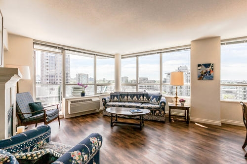 Expansive views & all the amenities for an active retirement at your doorstep in this sub-penthouse unit in the prestigious Terraces on 7th. Newly refinished with high-grade laminate & fresh paint & updated bathrooms. Kitchen has maple cabinetry & granite countertops. Terraces is a lively, 50 plus residence with a mandatory service package ($1,026/month for one person, $1,470 for two) that includes: weekly housekeeping, meals in the dining room, fitness centre, library, theatre, emergency response, coffee shop & much more. Plus, you are steps away from the shops & restaurants on South Granville, Granville Island & the waterfront walkway along False Creek. Your perfect retirement is right here! Viewings by appointment.