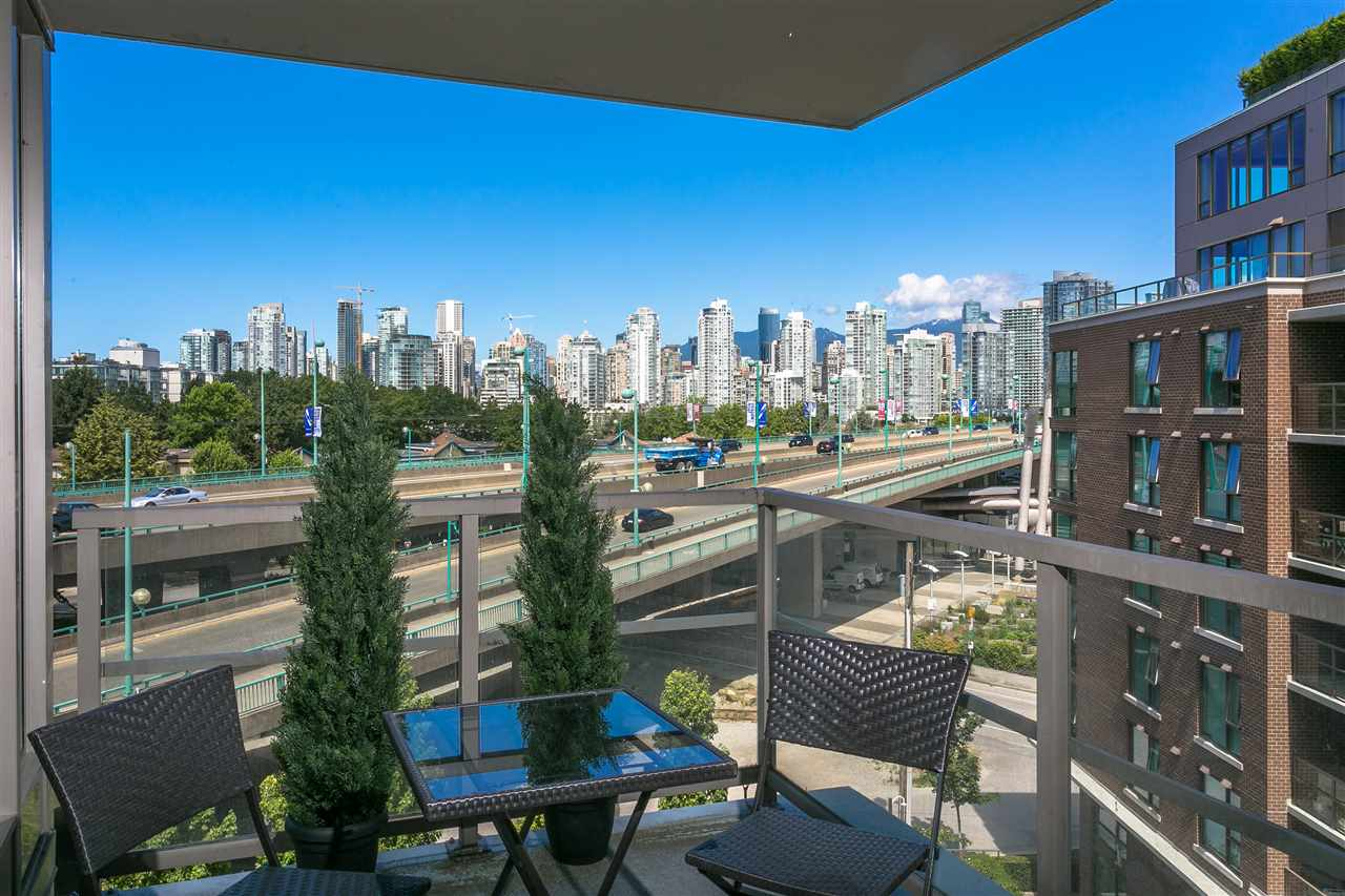 Welcome home to Western Exposure City & Mtn Views at the 2012 built Maynards Block in Athlete's Village! Bathed in natural light and in immaculate move in condition, this corner suite has rich dark hardwood floors, granite counters, stainless appliances, and a great usable open plan. Western exposure balcony is perfect for BBQing & outdoor dining. The bedrooms are separated for privacy plus insuite storage plus a solarium. Maynards Block is steps to the Seawall, Whole Foods, Canada Line, Charleson & Hinge Park, VGH, Granville Island, Downtown & Olympic Village. Great amenities including Concierge, Gym, Yoga Room & much more! Includes 1 parking. Call to confirm the open houses or a private showing. *** Open House on Sat/Sun 2-4pm ***