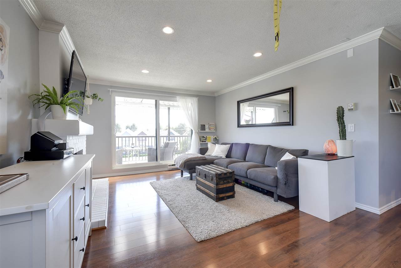 Top floor corner unit at Ladner Place! This bright, two bedroom home features nearly 960 sq.ft of living space and has been recently renovated including new bathroom vanity in 2017, new windows & sliding glass door in 2016, new bath tub & deck surface in 2015 and hardwood floors in 2010. Conveniently located just steps to Ladner Village, Memorial Park, local schools & countless amenities, this stunning location cannot be beat!!! 1 parking stall and storage locker included. Large, south facing entertainers balcony and extra insuite storage.