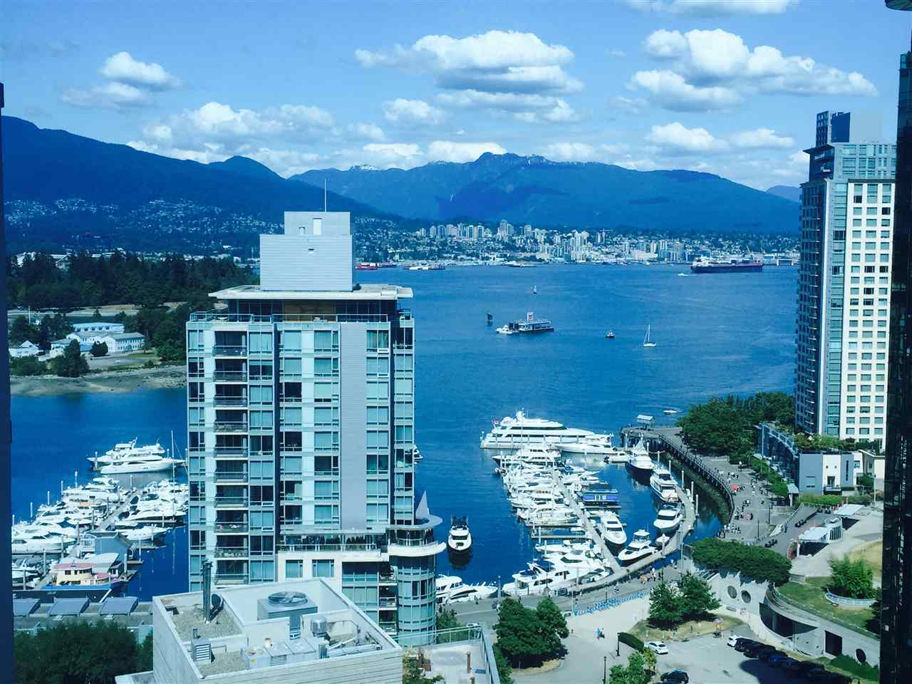 PRIME LOCATION!! Overlooking Coal Harbour, city night view & the marina. Facing North, East and South. Steps to Stanley Park, Coal Harbour and English Bay! In the heart of Downtown just minutes away to Vancouver's BEST SHOPPING and BEST Restaurants. Enjoy bright and open plan designer home featuring two bedrooms, two baths, new renovated and enclosed kitchen,  new appliances and laundry, new laminate floor. Featuring TWO Parkings, guest parking, pool, Jacuzzi and gym. HURRY! One of a kind corner suite with three balconys. Sorry No Pets.