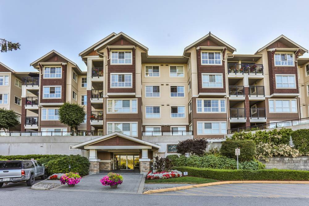 Fabulous 2 bdrm corner unit on the top floor. Open concept kitchen boasts SS appliances & granite counters. Dining/living rm features high end laminate flooring and updated F/P mantle with electric F/P. Look on to the manicured court yard from covered deck. This suite offers a storage locker in addition to the insuite storage. UPSTAIRS, you'll find a loft ideal for an office space and a private roof top patio. Enjoy the mountain & golf course views from the private patio. Insuite laundry: NEW Washer & Dryer. 1 parking stall included. Exceptional amenities include gym, sauna, guess suite, pool table, club house, kids room, hobby room. Close to WCE station, shopping, theatre, GE bridge & Pitt River Bridge. OPEN HOUSE SAT & SUN JULY 29 & 30th 2-4pm