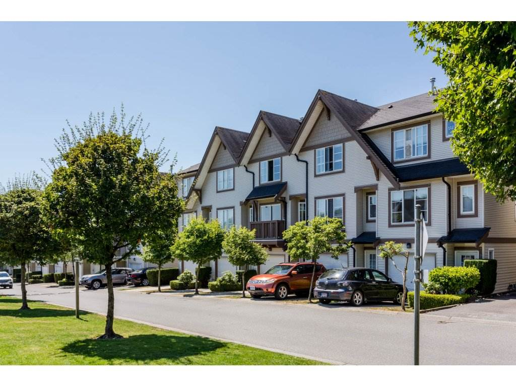 Amberleigh. Immaculate 2 bedroom unit well located in the complex facing a greenspace. Lots of renos inc. paint, light fixtures, new laminate throughout main level and foyer, New carpeting in stairwells and hallway. Bright kitchen with walk out to west facing fenced back yard with custom 13'6 x 11 Trex composite deck and vegetable garden. Spacious Master bedroom with custom closet organizers and 4 piece ensuite. Well run complex with healthy contingency fund close to shopping, transit and many restaurants. Clubhouse amenities include outdoor pool, hot tub, large gathering space and exercise room. Tandem garage plus room for one more in the driveway. Open house Sunday July 30 2-4