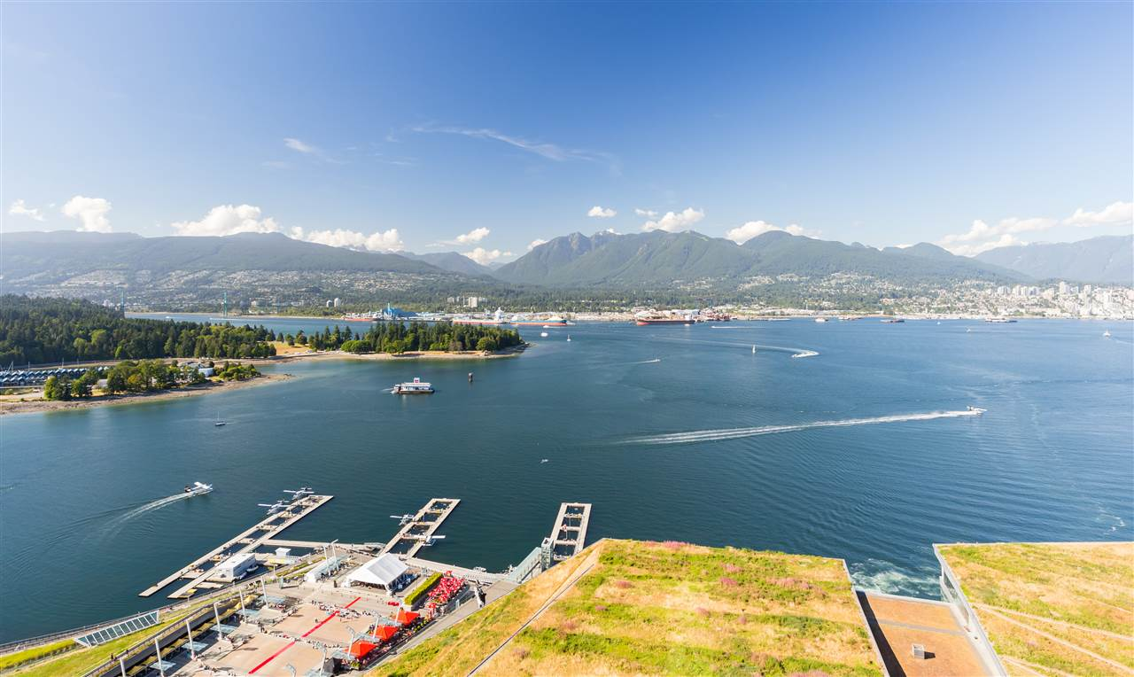 Welcome to the Fairmont Pacific Rim?a collection of ultramodern luxury residences designed by award-winning architect James Cheng. At 2,320 Sq.Ft., this SPECTACULAR WATERFRONT home in the highly coveted Coal Harbour area offers UNPARALLELED PANORAMIC views of the majestic North Shore mountains, the calming waters of Burrard Inlet, and world-renowned Stanley Park. Inside, you will delight in the abundance of detailed custom-work completed throughout: murphy bed organizers, shelving, closets in bedrooms and office, surrounding wall piece for fireplace, quartz counter-top and cabinets for kitchen island, waterfall feature in living room & plenty more. Enjoy resort-style amenities including 24-hour concierge, outdoor pool, spa, fitness centre, theatre room & limousine service.