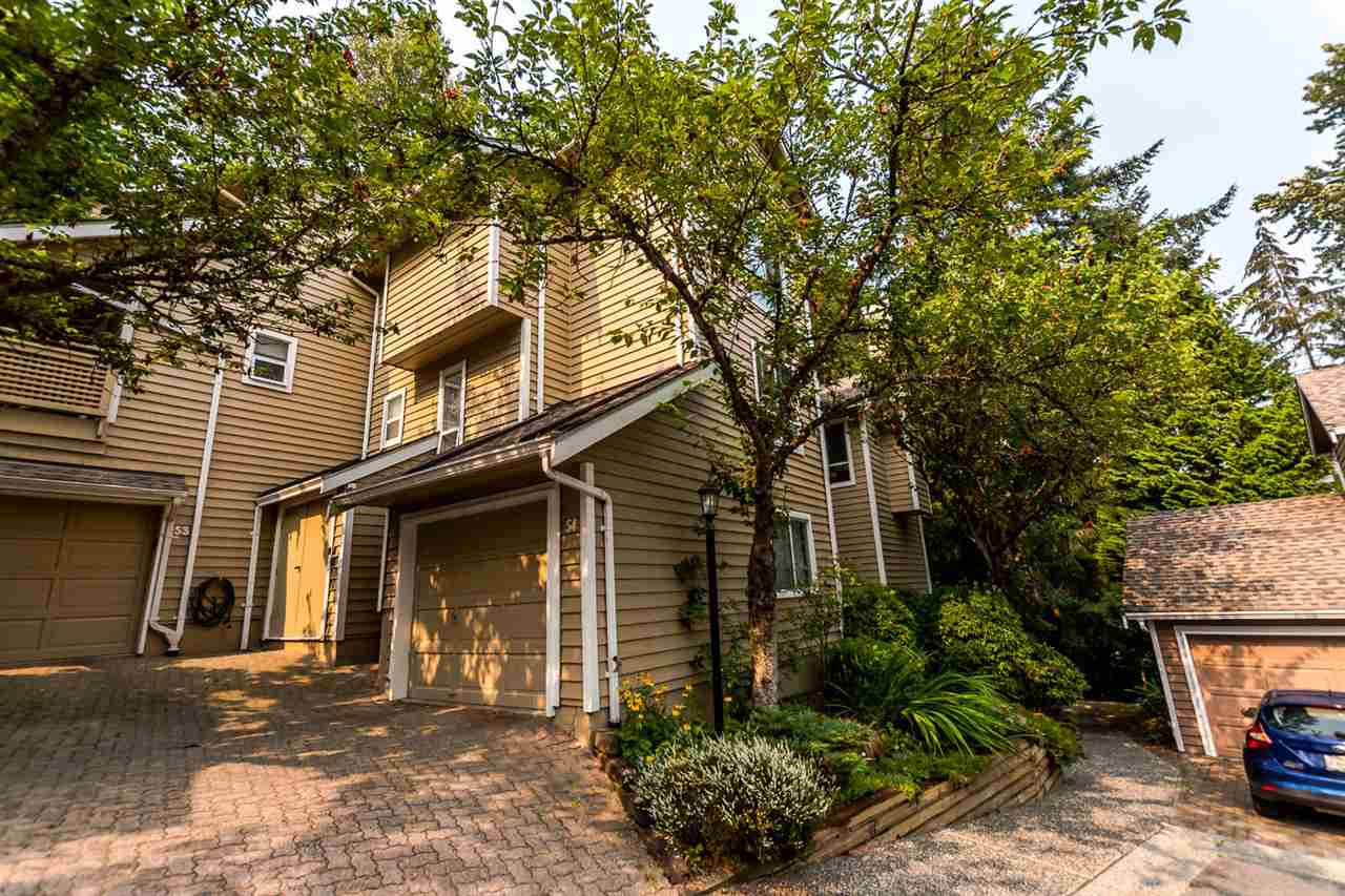 Huge END UNIT townhouse with great renovated kitchen and stainless steel appliances with breakfast bar. Engineered 'high durability' hardwood on the main, newer roof. Bright and spacious open floor plan with a vaulted living room ceiling surrounded by large windows in a serene view of the greenbelt. 2 large bedrooms up with ensuites. Master has a walk-in closet. Downstairs offers a huge 3rd bedroom (Big enough to be a gym or rec room,ect. ). Single car garage. Walk to more parks than you can handle and the elementary school.  All measurements approximate.