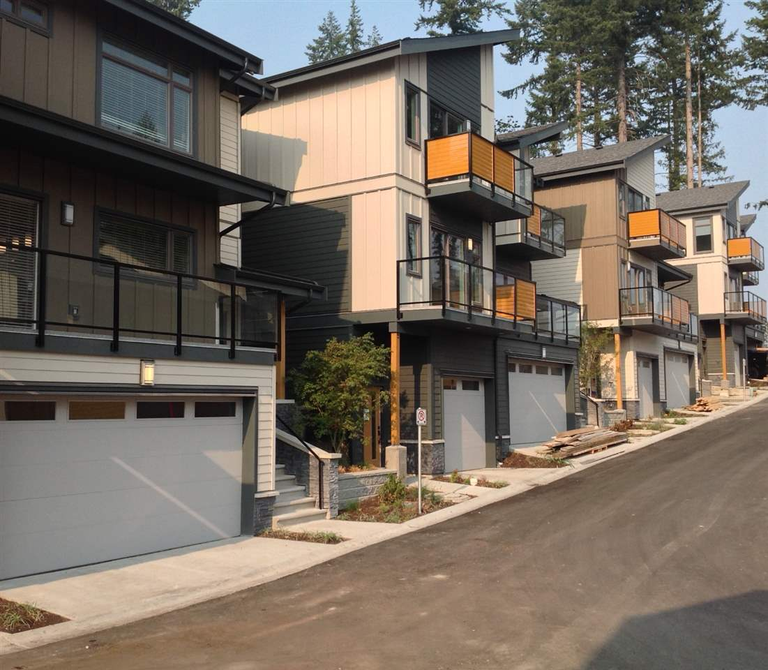 A unique collection of 3 bedroom view homes in picturesque Smiling Creek neighbourhood on Burke Mountain. Surrounded by unparalleled natural beauty, this limited collection of 36 artfully crafted, contemporary style townhomes are perfect for the growing family or active downsizer. With homes ranging from 1593 to 1884 square feet there is a size that fits everyone's needs, all just moments from the existing and future amenities of The Foothills community.  Show Home at  unit #111 3525 Chandler Street.  Open House Tues & Thursday  2:30 to 4:30 pm. Saturday  & Sunday 2:30pm to 4:30pm  VIDEO https://youtu.be/RNGUSIG0Qw4