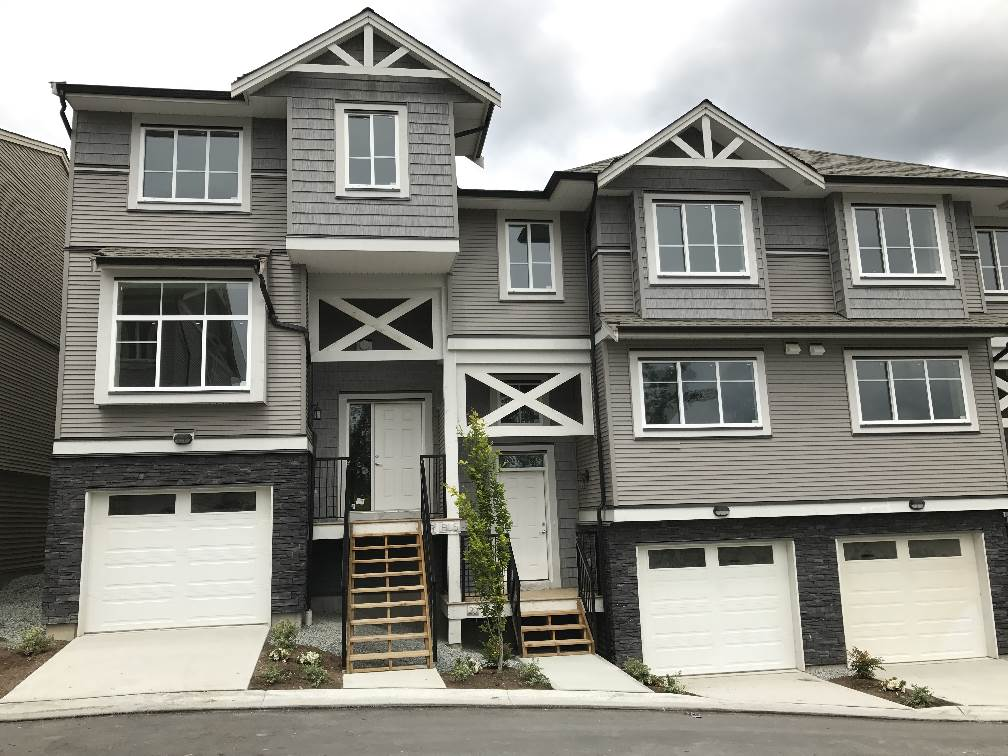 """Cottonwood Ridge"" Deluxe townhomes. Features 3 bedroom, 3 bathrooms, Maple kitchen with quartz counters, B/I microwave over the range, stainless steel appliances, and washer & dryer, gas fireplace, gas furnace, fire protection, sprinkler system, double tandem garage, ensuite, finished basement & 10 year warranty."