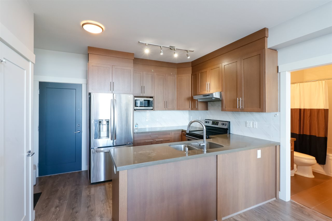 This Bright South facing Penhouse unit with super high cellings .Great Mt. Baker & Fraser River view and Efficient open layout plan with two bedroom on each side. comes with 2 parking lots and 1 locker. Located in heart of coquitlam, close to skytrain,Community Parks, restaurants and 9-hole golf courses. Dont miss out!! OPENHOUSE OCT 22 2-4pm