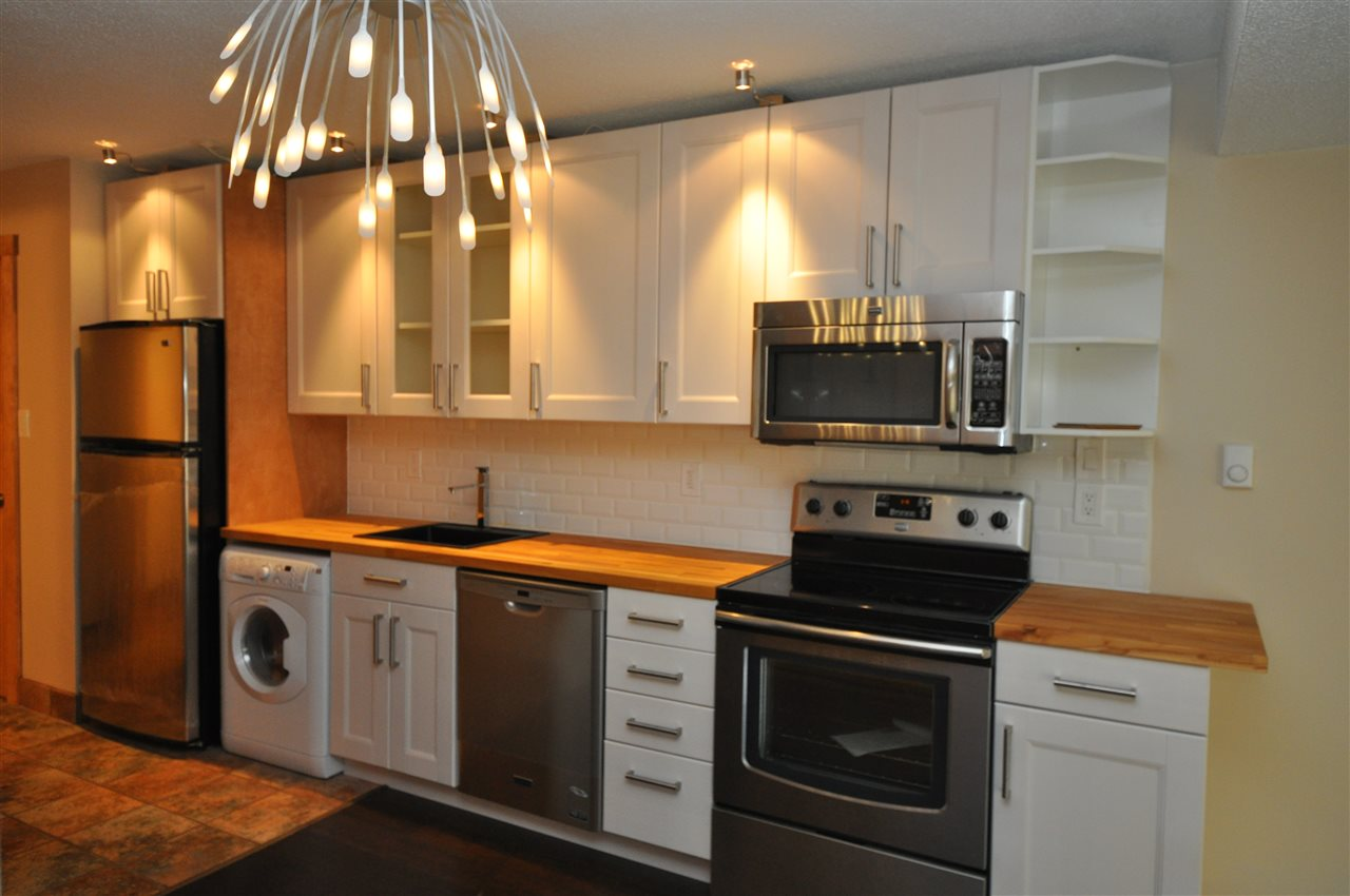 A truly classic Whistler townhome with a tasteful modern update. This spacious open concept studio features updated kitchen with stainless steel Maytag appliances, remodelled bathroom, accent lighting, custom heated floor tiles in the bathroom & kitchen, bamboo flooring, new murphy bed, hand milled Gabriola wood accents, all-in-one washer/dryer - just waiting for you to move in and enjoy.  This unit offers rare river frontage with unobstructed mountain and nature views.. The highly sought after Adventures West Riverside Complex also offers private beach access on Alta Lake and you are only minutes from the world renowned vibrant Whistler Village via the Valley Trail and/or local transit.