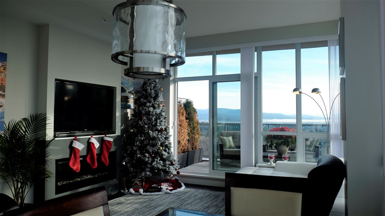 VERY PRIVATE PENTHOUSE with wrap around  413 sq.ft. balcony.  South and East facing with stunning views of the Sunrise, Mt Baker to Fraser River, Port Mann bridge and Gulf and San Juan Islands. Features include, air conditioning, gourmet kitchen with gas stove, all Bosch appliances. Engineered hardwood flooring 2 bed 2 bath with den, separate laundry room and plenty of storage space. 2 parking stalls & extra large storage locker right next to the elevator.  Air conditioning /heating unit servicing contract not included in maintenance fee ($15 month).Exclusive, private community recreation center featuring; theater room, executive meeting rooms, basketball/volleyball court, pool/games room, ping-ping tables, swimming pool with Jacuzzi. Private community center also features a Guest Suite and Banquette Facilities. Sky Train 5 minute walk. Open house Sun Oct 29th 3pm-5pm buzz 5818  OWNER MOTIVATED CALL TODAY!