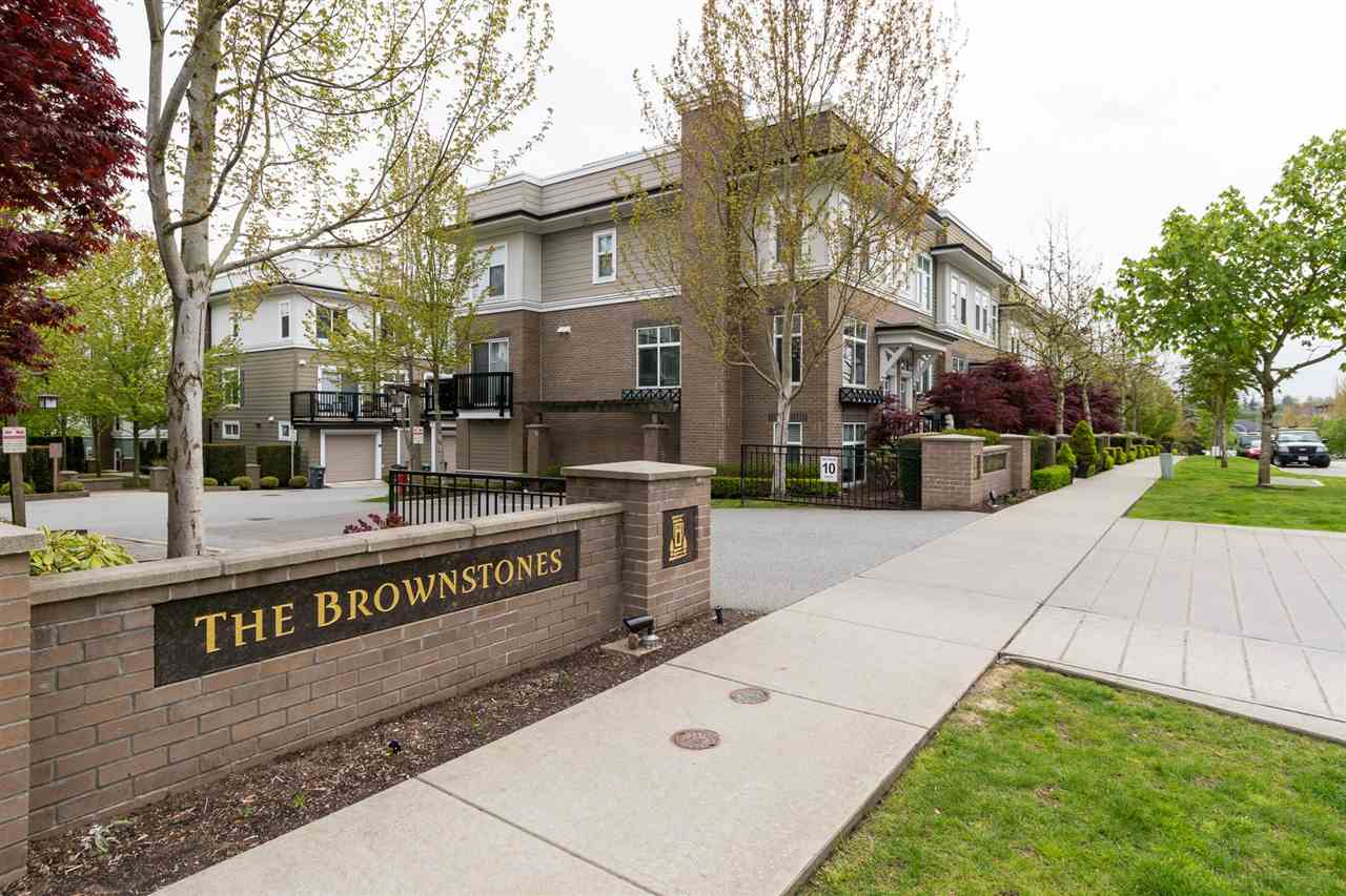 Brownstones End Unit! Roof top deck with a view of the mountains. 3 bedrooms, 2 full baths open floor plan. Walk in on the main floor to the open living, dining & kitchen area. Hardwood floors are one of the upgrades in this lovely unit. Large balcony off the kitchen perfect for barbecuing. Upstairs the master suite features walk in closet & ensuite. Main bath for 2 bedrooms to share. Tandem 2 car garage. This ENDD unit sits in the middle of the complex, quiet location. Close to shopping & schools. 2 pets allowed!